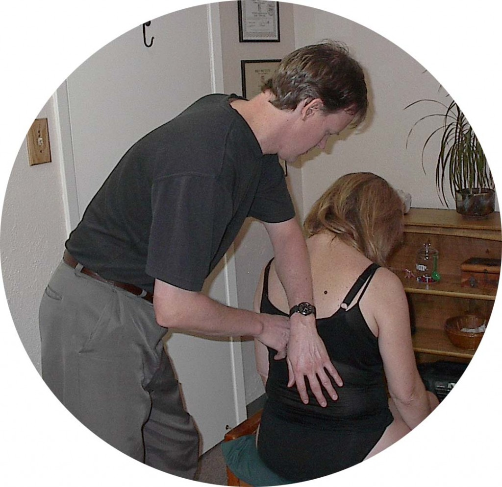 Sam Johnson works with Rolfing client for neck and shoulder pain